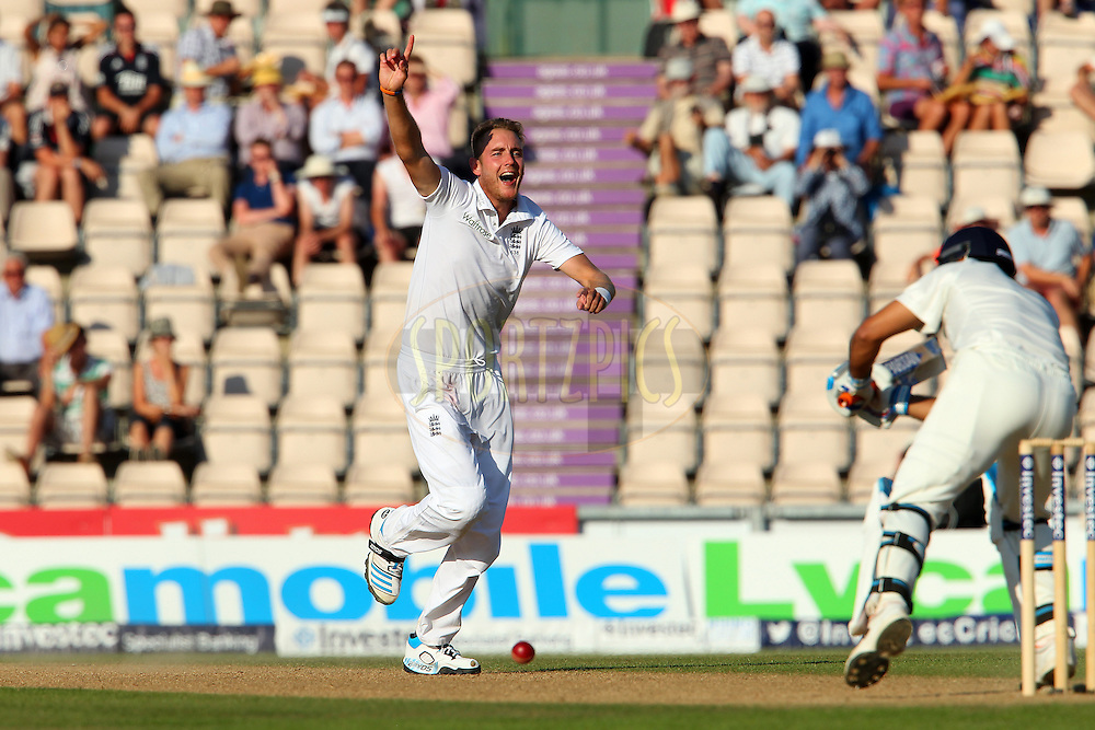 Stuart Broad of England appeals in vain for the wicket of Mahendra Singh Dhoni captain of India during day three of the third Investec Test Match between England and India held at The Ageas Bowl cricket ground in Southampton, England on the 29th July 2014<br /> <br /> Photo by Ron Gaunt / SPORTZPICS/ BCCI