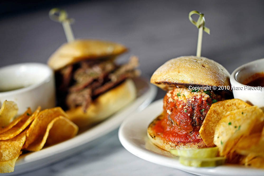SHOT 9/2/10 2:53:33 PM - LoHi Steakbear food and drink menu items at the Denver, Co. neighborhood bar and restaurant. Jumbo Meatball Slider on rosemary rolls with our handmade red gravy $7.(Photo by Marc Piscotty / © 2010)