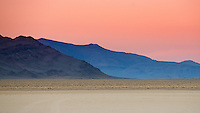 Sunset at dry lakebed at Death Valley National Park, California