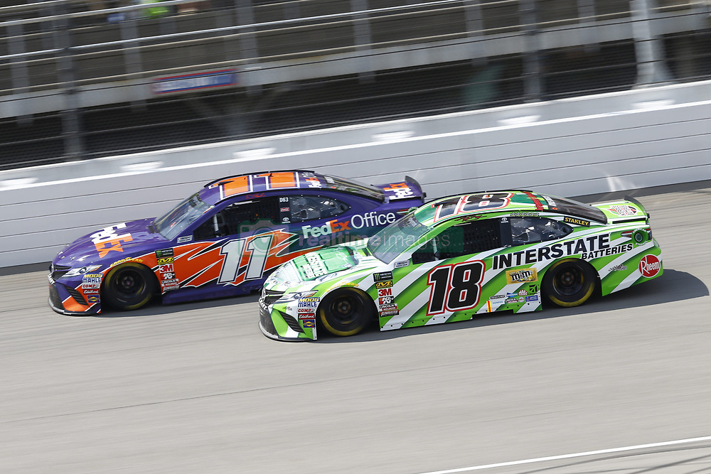 August 12, 2018 - Brooklyn, Michigan, United States of America - Denny Hamlin (11) and Kyle Busch (18) battle for position during the Consumers Energy 400 at Michigan International Speedway in Brooklyn, Michigan. (Credit Image: © Chris Owens Asp Inc/ASP via ZUMA Wire)