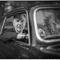 Global Head of Car Design for GM, Mike Simcoe, with his vintage Lancia. Picture by Shannon Morris