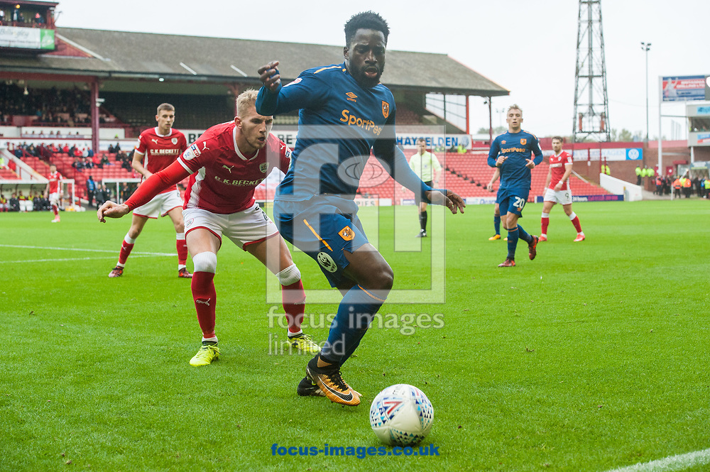 Nouha Dicko of Hull City holds the ball up ahead of Jason McCarthy of Barnsley during the Sky Bet Championship match at Oakwell, Barnsley<br /> Picture by Matt Wilkinson/Focus Images Ltd 07814 960751<br /> 21/10/2017