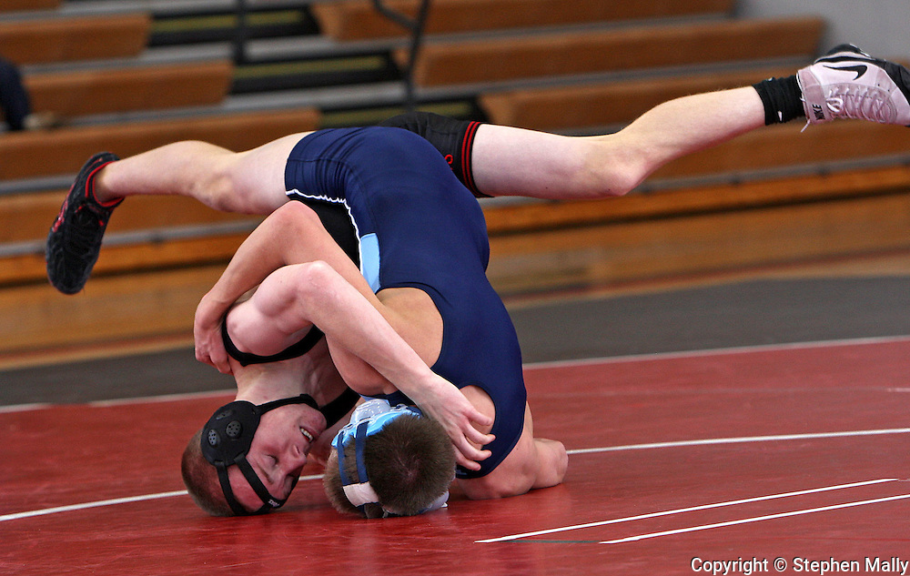 Linn-Mar's Dan Radig (from left) and Jefferson's Blake Carson battle for control in the 125 pound match at the Jefferson at Linn-Mar dual meet at Linn-Mar High School in Marion on Thursday January 14, 2010. (Stephen Mally/Freelance)