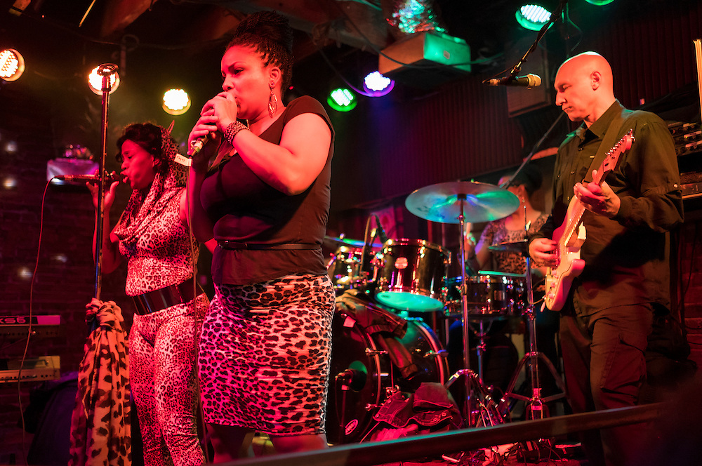 NEW ORLEANS - CIRCA FEBRUARY 2014: Band performing and dancing in a nightclub during the Mardi Gras celebration in the French Quarter in New Orleans