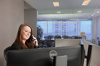 Receptionist answering phone Towson MD offices of Business Suites, by Jeffrey Sauers of Commercial Photographics