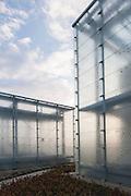 Translucent glass facades. Silesian Museum, Katowice, Poland. Architect: Riegler Riewe Architekten , 2014.