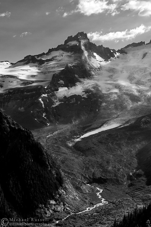 Little Tahoma Peak (3395 m / 11138 ft) and the Emmons Glacier on the north east flank of Mount Rainier. Melt water from the terminus of the Emmons Glacier forms the White River at the top of the White River Valley.  Photographed from the Sunrise Rim Trail in the Sunrise area of Mount Rainier National Park, Washington State, USA.