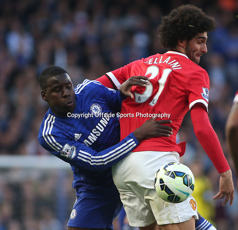 18 April 2015 - Barclays Premier League - Chelsea v Manchester United - Kurt Zouma of Chelsea battles with Marouane Fellaini of United.<br /> <br /> <br /> Photo: Ryan Smyth/Offside