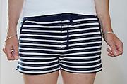 woman wearing blue white striped summer short pants