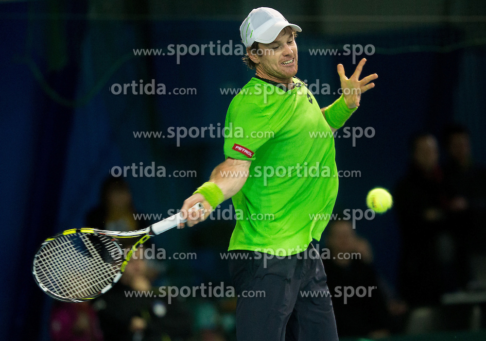 Blaz Kavcic of Slovenia (green) plays against Gastao Elias of Portugal (red) during 2nd match of Davis cup Slovenia vs. Portugal on January 31, 2014 in Kranj, Slovenia. Photo by Vid Ponikvar / Sportida