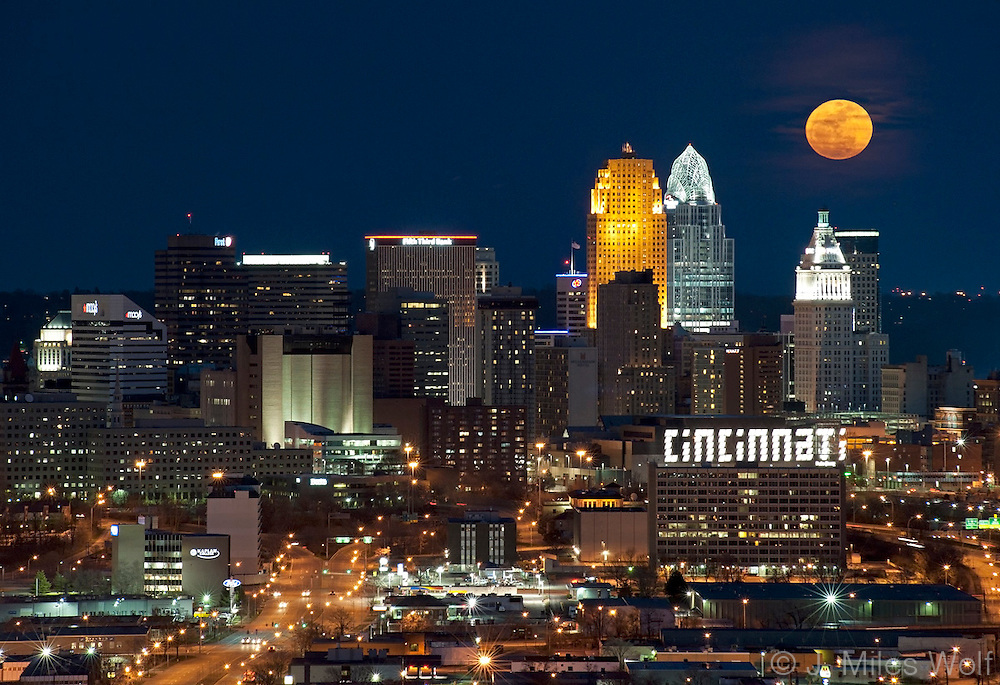 The Downtown Cincinnati Skyline at Twilight with a rising Super Moon