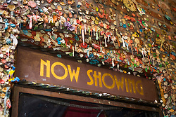 United States, Washington, Seattle. The gum wall in Post Alley in downtown Seattle. Begun in 1993, the wall was added to for over 20 years until it was cleaned in 2015. However gum is accumulating again.