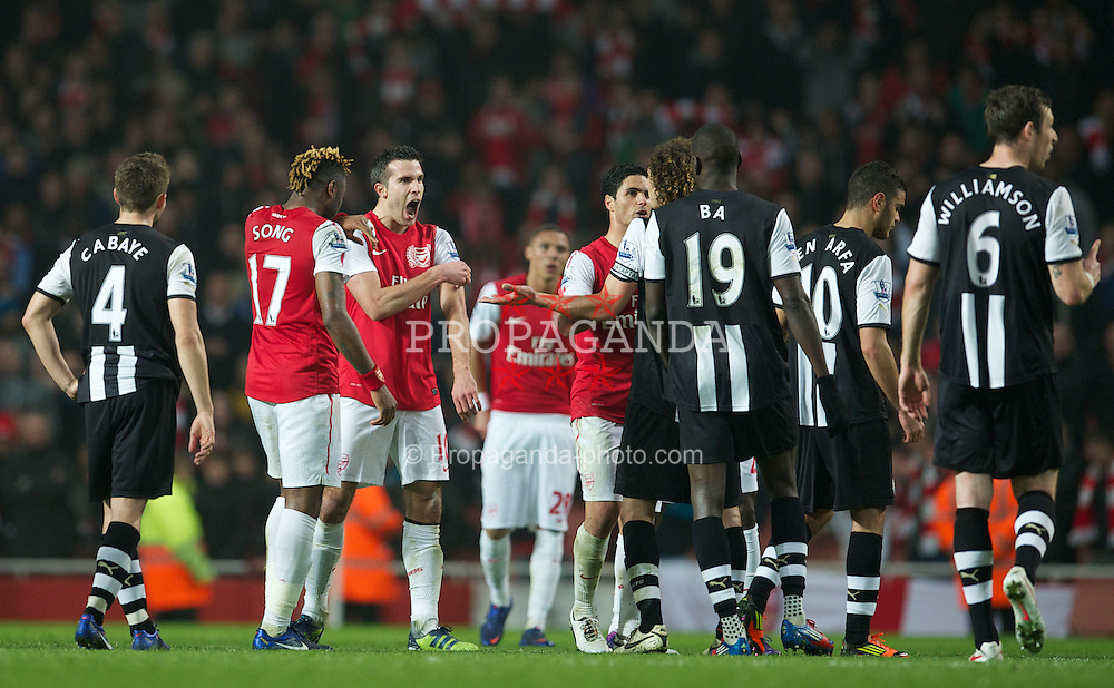 LONDON, ENGLAND - Monday, March 12, 2012: Arsenal's Robin Van Persie celebrates his side's second goal by taunting the Newcastle United players during the Premiership match at the Emirates Stadium. (Pic by David Rawcliffe/Propaganda)