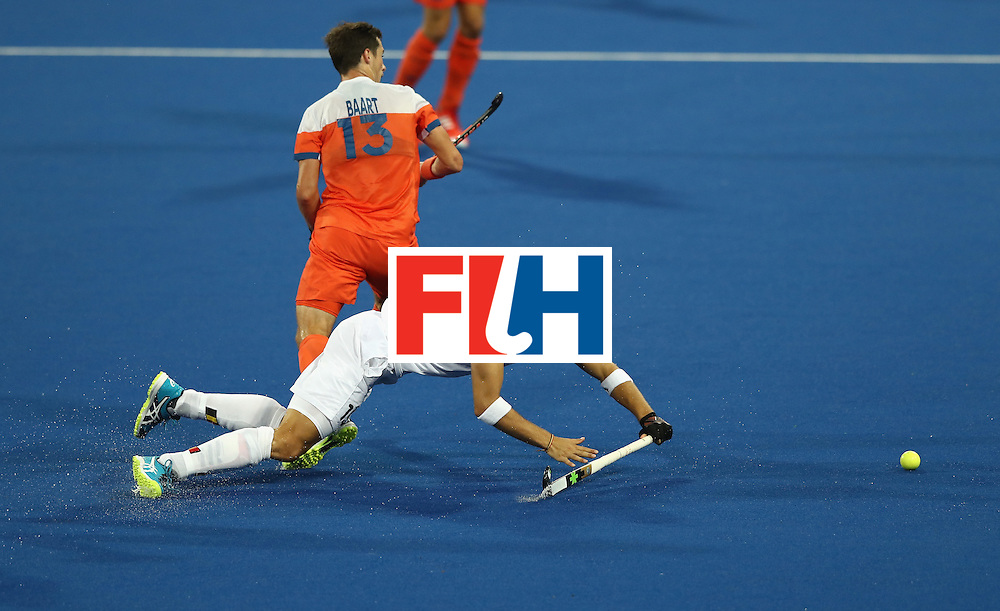 RIO DE JANEIRO, BRAZIL - AUGUST 16:  Emmanuel Stockbroekx of Belgium stretches for the ball during the Men's semi final hockey match between Belgium and the Netherlands on Day 11 of the Rio 2016 Olympic Games held at the Olympic Hockey Centre on August 16, 2016 in Rio de Janeiro, Brazil.  (Photo by David Rogers/Getty Images)