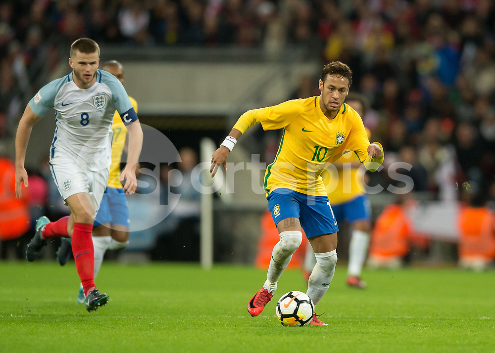 Neymar of Brazil is chased by Eric Dier of England during the International Friendly match between England and Brazil at Wembley Stadium, London, England on 14 November 2017. Photo by Vince Mignott.