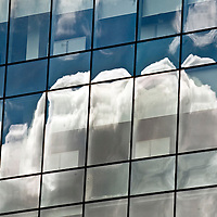 Picture of the Day. Heading back to Glasgow from an assignment I was sat at the traffic lights I saw this wonderful reflection of clouds on the building of the new Tesco Bank offices in Cowcaddens. I pulled over my car and managed to capture this image. Picture Christian Cooksey.