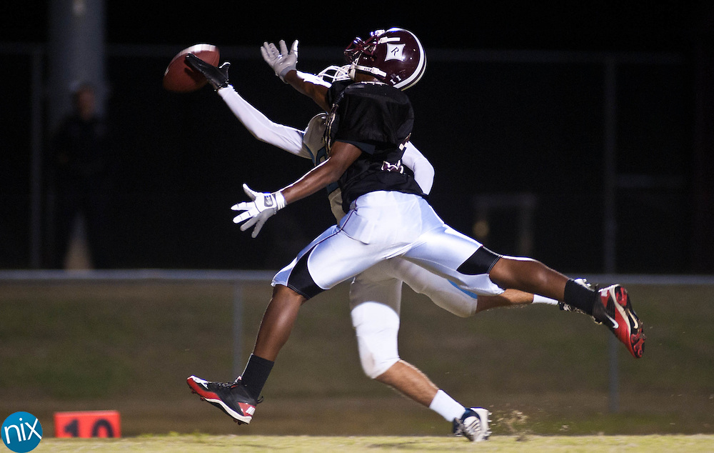 Piedmont's Colton Greene breaks up a pass to Jay M. Robinson's Carl Tucker Monday night in Concord. The game was originally set for Sept. 2, but was postponed due to weather. (Photo by James Nix)