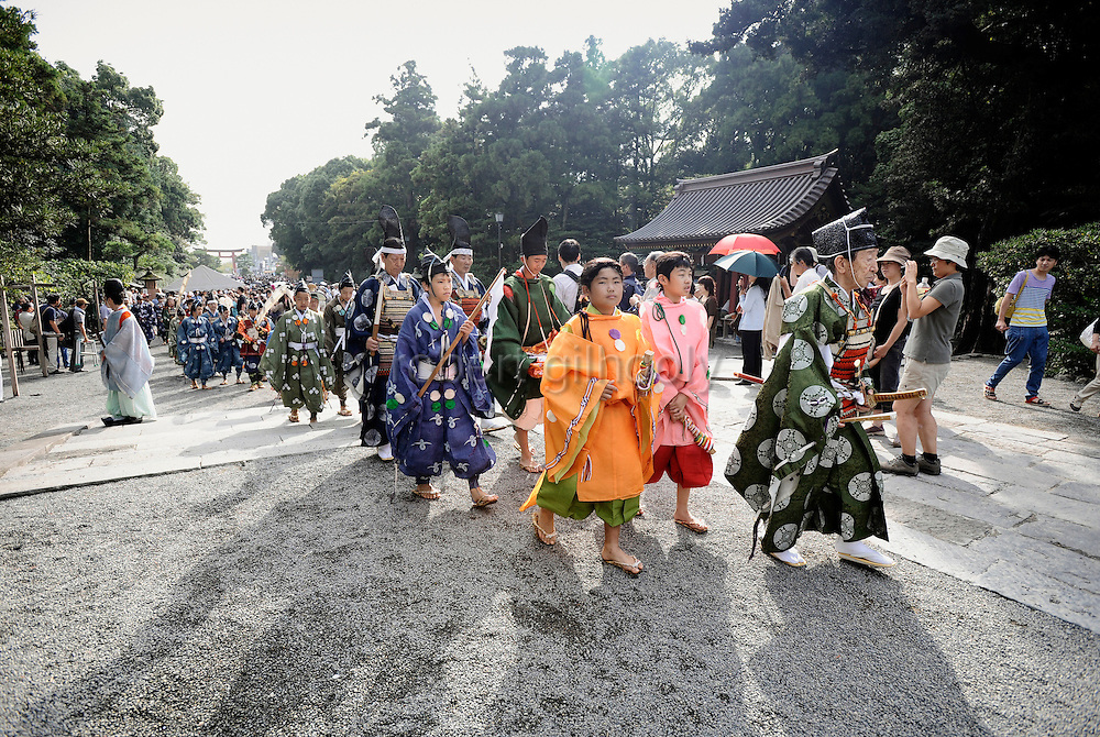 A horseback archer dressed in traditional hunting garb is escorted along a 255-meter course during the Yabusame Shinji, a Japanese ritual, at Tsurugaoka Hachimangu shrine in Kamakura, near Tokyo. The ritual, which involves several riders on horseback firing arrows at targets while galloping at speed, dates back to the 12th century and is aimed at appeasing the numerous gods that guard Japan. It was initiated by Kamakura shogun Minamoto no Yoritomo in an attempt to improve his samurai warrior's appalling archery skills..Photographer: Robert Gilhooly