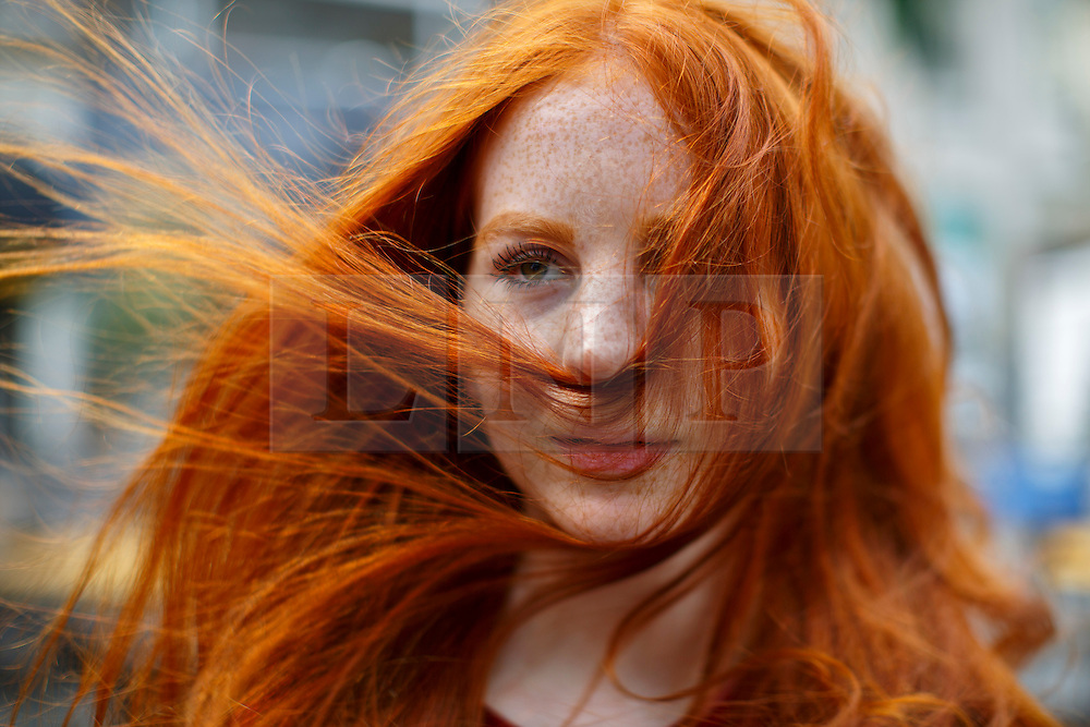 © Licensed to London News Pictures. 04/09/2016. Breda, The Netherlands. Emily Neumann attends The Redhead Days festival as thousands of redheads fill a Dutch city Breda to celebrate International Redhead Day event in The Netherlands on Sunday, 4 September 2016. Every year natural redheads from more than 80 countries come together at 'Roodharigendag' annual weekend long festival to celebrate their ginger genes. The event also holds the world record for the largest number of natural redheads being in one place. Photo credit: Tolga Akmen/LNP