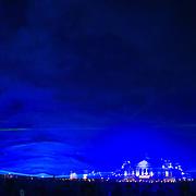 NLD/Amsterdam/20150513 - Kunstenaar Daan Roosegaarde verlicht het Museumplein in Amsterdam met zijn kunstwerk 'Waterlicht'. Hiermee wil Roosegaarde de bezoeker de bijna vergeten kracht en kwetsbaarheid van water laten ervaren. 'Waterlicht laat je ervaren hoe Nederland eruit zou zien zonder waterwerken, een virtuele overstroming.Het schouwspel bestaat uit golvende lijnen van licht gemaakt met de nieuwste LED-technologie, software en lenzen. Waterlicht is te zien op een hoogte van hoogte van ruim 2 meter, een waterniveau dat heel Amsterdam zou bereiken zonder menselijk ingrijpen.