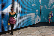 Women attending London Fashion Week's 2nd day, pose against the event's backdrop in Somerset House. London Fashion Week is one of the highest profile fashion events in the world. There are 50 or so catwalk shows on the official schedule as well as further 45+ show off schedule.