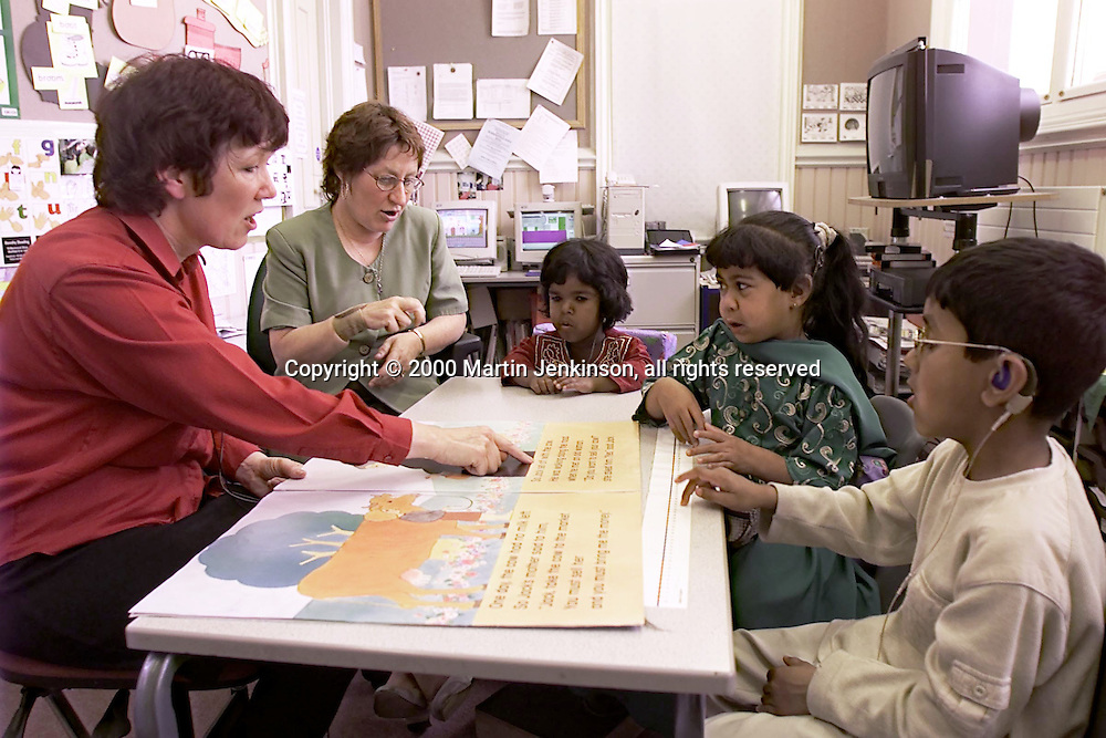 """Signer assists Teacher during """"Literacy Hour"""" teaching of hearing impaired pupils....© Martin Jenkinson tel 0114 258 6808  mobile 07831 189363 email admin@pressphotos.co.uk  NUJ recommended terms & conditions apply. Copyright Designs & Patents Act 1988. Moral rights asserted credit required. No part of this photo to be stored, reproduced, manipulated or transmitted by any means without prior written permission."""