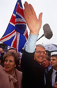British Prime Minister, John Major and wife Norma wave to supporters at the Conservative party conference on 11th October 1991 in Blackpool, England.