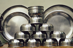 Stainless steel kitchen ware stacked up; Punjab; India,
