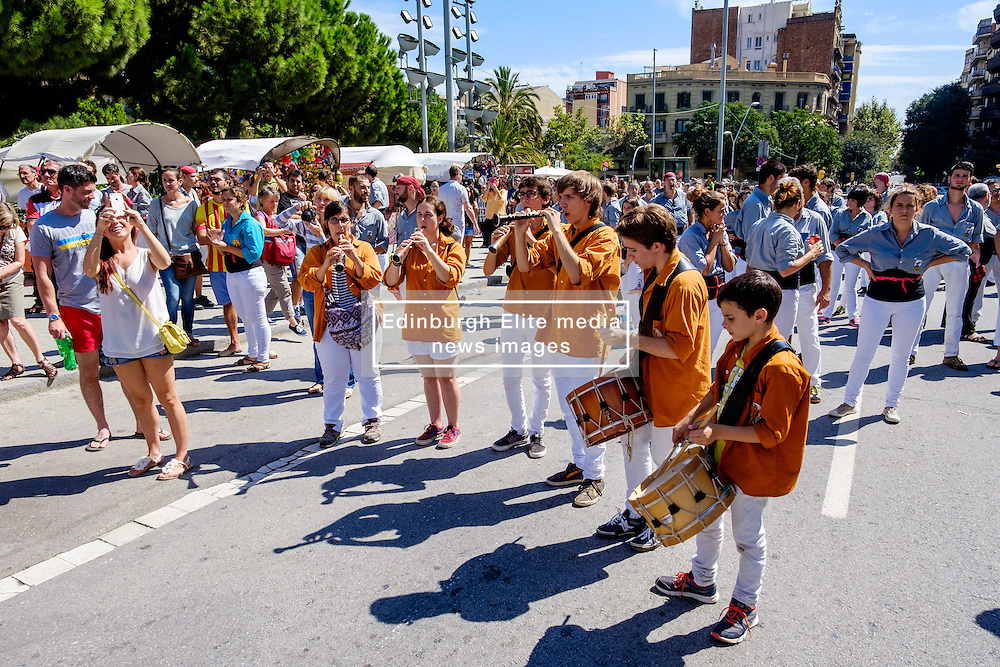 A traditional band plays to accompany the Castellers building human towers at the Sagrada Família, Barcelona, Catalonia, Spain<br /> <br /> (c) Andrew Wilson | Edinburgh Elite media