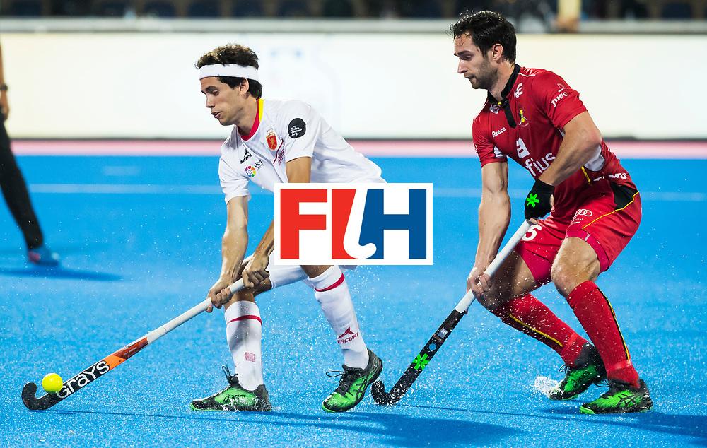 BHUBANESWAR - Enrique Gonzalez (Esp) met Loick Luypaert (Bel).  Hockey World League finals , wedstrijd om de 5e plaats. Belgie-Spanje.  COPYRIGHT KOEN SUYK