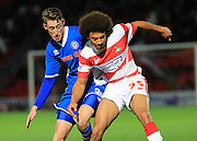 Joe Bunney, Keshi Anderson during the Sky Bet League 1 match between Doncaster Rovers and Rochdale at the Keepmoat Stadium, Doncaster, England on 21 November 2015. Photo by Daniel Youngs.