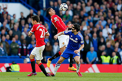Chris Smalling of Manchester United is challenged by Cesc Fabregas of Chelsea - Photo mandatory by-line: Rogan Thomson/JMP - 07966 386802 - 18/04/2015 - SPORT - FOOTBALL - London, England - Stamford Bridge - Chelsea v Manchester United - Barclays Premier League.