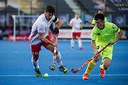 England's Adam Dixon is watched by Zhiwei Ao of China. England v China - Hockey World League Semi Final, Lee Valley Hockey and Tennis Centre, London, United Kingdom on 15 June 2017. Photo: Simon Parker