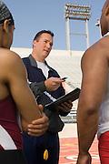 Trainer instructing runners