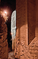 Close-up of a night time passageway at the Papal Palace in Avignon, France.