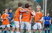 BLOEMENDAAL - aanvoerder Joppe van Liebergen (Bldaal)  scoort 3-2  tijdens de competitiewedstrijd hockey jongens B , Bloemendaal JB1-Breda JB1 (3-2)  , rechts Tobias Bovelander  en COPYRIGHT KOEN SUYK