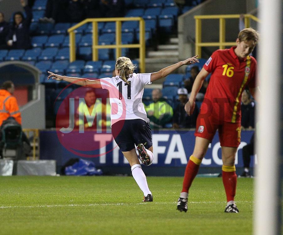 England's Toni Duggan (Everton) wheels away to celebrate her goal - Photo mandatory by-line: Robin White/JMP - Tel: Mobile: 07966 386802 26/10/2013 - SPORT - FOOTBALL - The Den - Millwall - England Women v Wales Women - World Cup Qualifier - Group 6