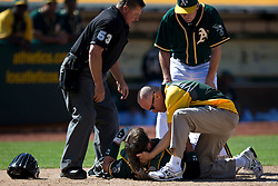 OAKLAND, CA - JUNE 22:  Derek Norris #36 of the Oakland Athletics is examined by assistant athletic trainer Walt Horn, manager Bob Melvin #6 and umpire Greg Gibson #53 after getting hit in the head with a bat by Jonathan Herrera (not pictured) of the Boston Red Sox during the tenth inning at O.co Coliseum on June 22, 2014 in Oakland, California. The Boston Red Sox defeated the Oakland Athletics 7-6 in 10 innings.  (Photo by Jason O. Watson/Getty Images) *** Local Caption *** Derek Norris; Walt Horn; Bob Melvin; Greg Gibson