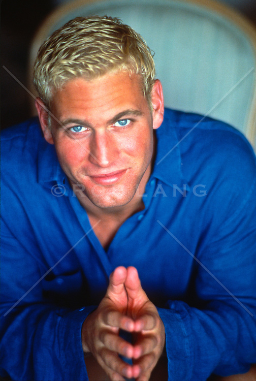 Good looking blond haired man looking at camera