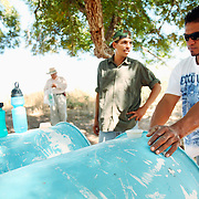 "Men fill up water containers on the Mexico/US Border near Agua Perieta, Mexico and Douglas, Arizona. Hundreds of undocumented immigrants pass across the desert here, and dozens die every year from dehydration and exposure. The men, part of a group called ""Agua Por Vida"" do not encourage people to cross the nearly 2,000 mile border but do not believe people should die needlessly."