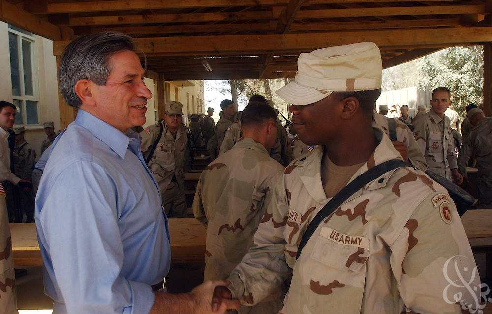 U.S. Deputy Defense Secretary Paul Wolfowitz shakes hands with a U.S. soldier during a visit to Bagram airbase in Afghanistan on July 15, 2002. Wolfowitz is currently touring the region and will meet with Afghan President Hamid Karzai before traveling to Turkey for meetings with coalition partners.