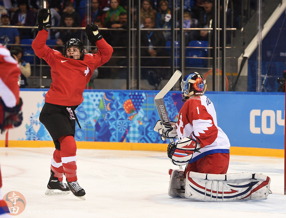 Feb 15, 2014; Sochi, RUSSIA; Switzerland forward Phoebe Stanz (88) reacts as Russia goalkeeper Anna Prugova (1) gives up a goal in a women's quarterfinals ice hockey game during the Sochi 2014 Olympic Winter Games at Shayba Arena.