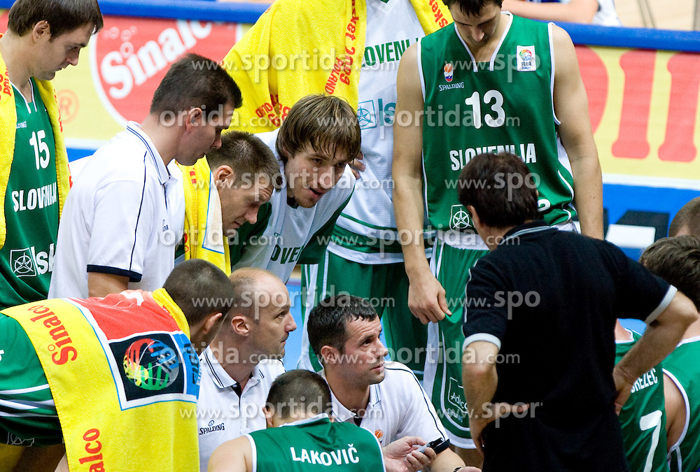 Head coach of Slovenia Jure Zdovc, Assistant coach of Slovenia Miro Alilovic and team during the basketball match at Preliminary Round of Eurobasket 2009 in Group C between Slovenia and Spain, on September 09, 2009 in Arena Torwar, Warsaw, Poland. Spain won 90:84 after overtime. (Photo by Vid Ponikvar / Sportida)