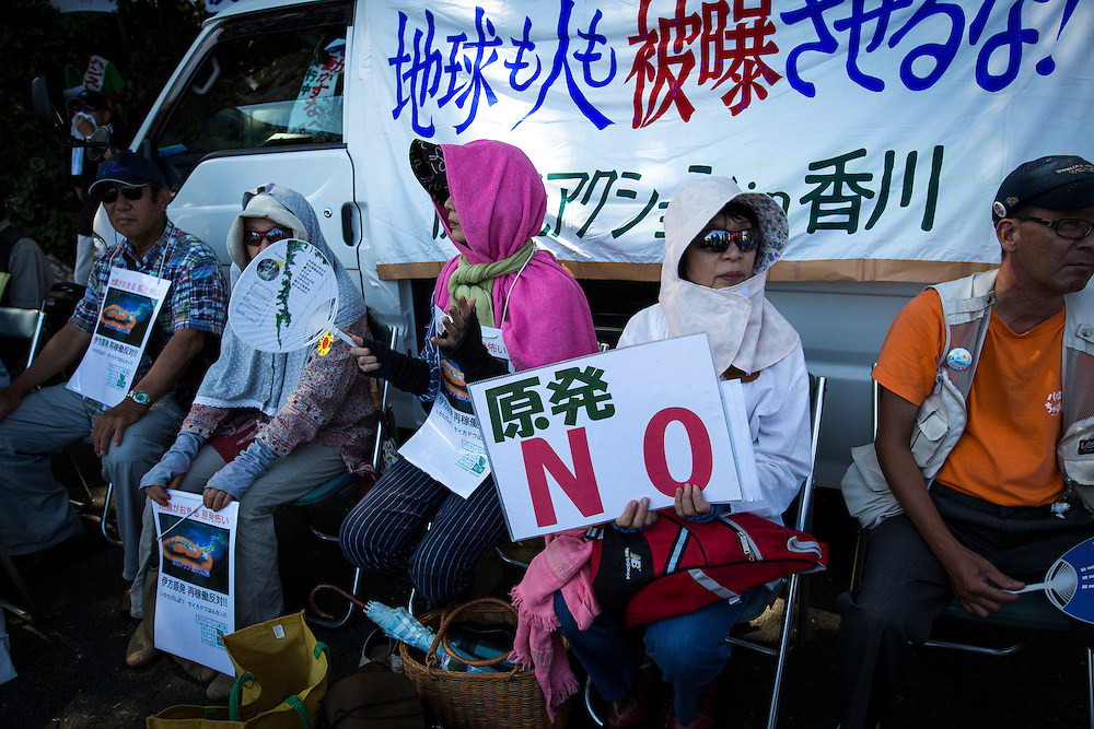 EHIME, JAPAN - AUGUST 11 : Anti-nuclear protesters with placards gather in front of Ikata Nuclear Power Plant to protest against the restarting of a nuclear reactor on August 11, 2016 in Ikata, Ehime prefecture, northwestern Shikoku, Japan. The No. 3 reactor of the nuclear plant is expected to resume operations this week after The Nuclear Regulation Authority (NRA's) has completed it's final inspections of the plant's operational safety measures. The plant has not generated nuclear power since Japan's 2011 nationwide shutdown of all nuclear plants in the aftermath of the Fukushima Daiichi nuclear disaster. Ikata Nuclear Power Plant will be the third nuclear power plant in Japan to become operational. (Photo by Richard Atrero de Guzman/NURPhoto)