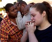 Aaron Camp, 18, left, comforts his brother Delante Stafford, 24, after their apartment they were living in with Stafford's girlfriend, Kindra Mello, 19, caught on fire while Camp was making a sloppy joe. Three apartments were completed consumed and three more apartments were partially affected. They lost everything including their mother's ashes in Sacramento, CA on April 12, 2005.