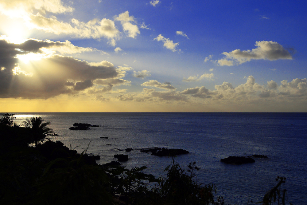 The sun sets over Waimea Bay.