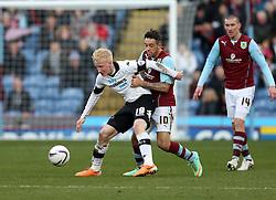 Derby County's Will Hughes battles with Burnley's Danny Ings - Photo mandatory by-line: Matt Bunn/JMP - Tel: Mobile: 07966 386802 22/02/2014 - SPORT - FOOTBALL - Turf Moor Stadium- Burnley - Burnley  v Derby County- Sky Bet Championship