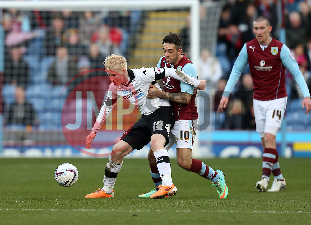 Derby County's Will Hughes battles with Burnley's Danny Ings - Photo mandatory by-line: Matt Bunn/JMP - Tel: Mobile: 07966 386802 22/02/2014 - SPORT - FOOTBALL - Turf Moor Stadium- Burnley - Burnley  v Derby County- Sky Bet Championship