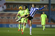 Brighton striker, Tomer Hemed (10) and Sheffield Wednesday defender Glenn Loovens (5) during the Sky Bet Championship match between Sheffield Wednesday and Brighton and Hove Albion at Hillsborough, Sheffield, England on 3 November 2015.