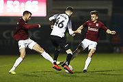 Sam Hoskins tackles Scott Malone during the The FA Cup match between Northampton Town and Derby County at the PTS Academy Stadium, Northampton, England on 24 January 2020.